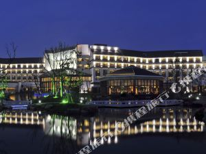 苏州独墅湖世尊酒店1晚+双人自助早餐+可选购自助晚餐/下午茶套餐,体验园林式酒店,小桥、流水,很有江南味道