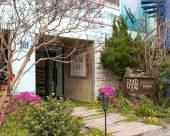 釜山海雲台鬆亭柔美海浪旅館