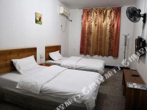 漳平萬仁酒店公寓