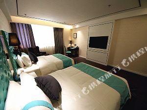 巴音郭楞希岸·輕雅酒店庫爾勒石化大道孔雀河店
