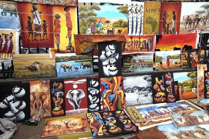 Half day Nairobi safari including Nairobi park,David shed rick and souvenir shop