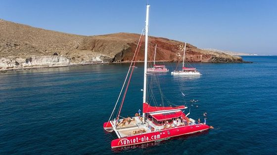 Sailing Catamaran Cruise in Santorini with BBQ, Drinks and Transfer