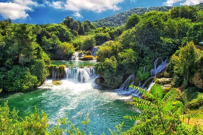 Krka Waterfalls with River Cruise Tour from Split