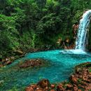 Celeste river waterfall and volcano guided rainforest hike and exuberant wildlife watching tour at Arenal in La Fortuna